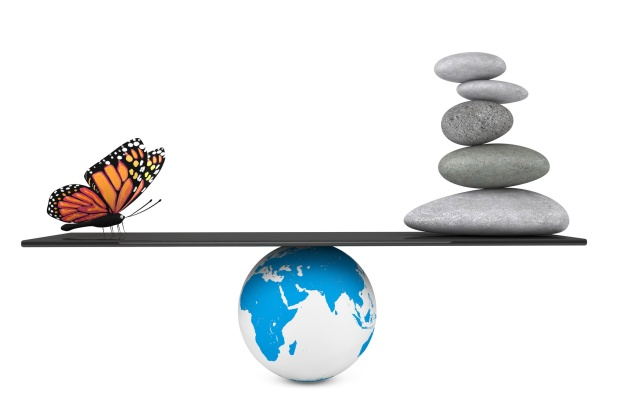 Stone pile in a Zen Garden with butterfly balanced on a Earth gl